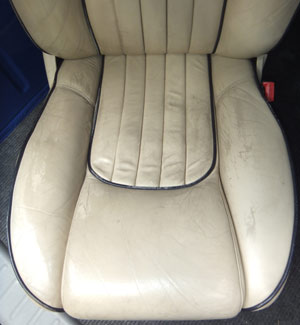Worn Leather Care Seat Before